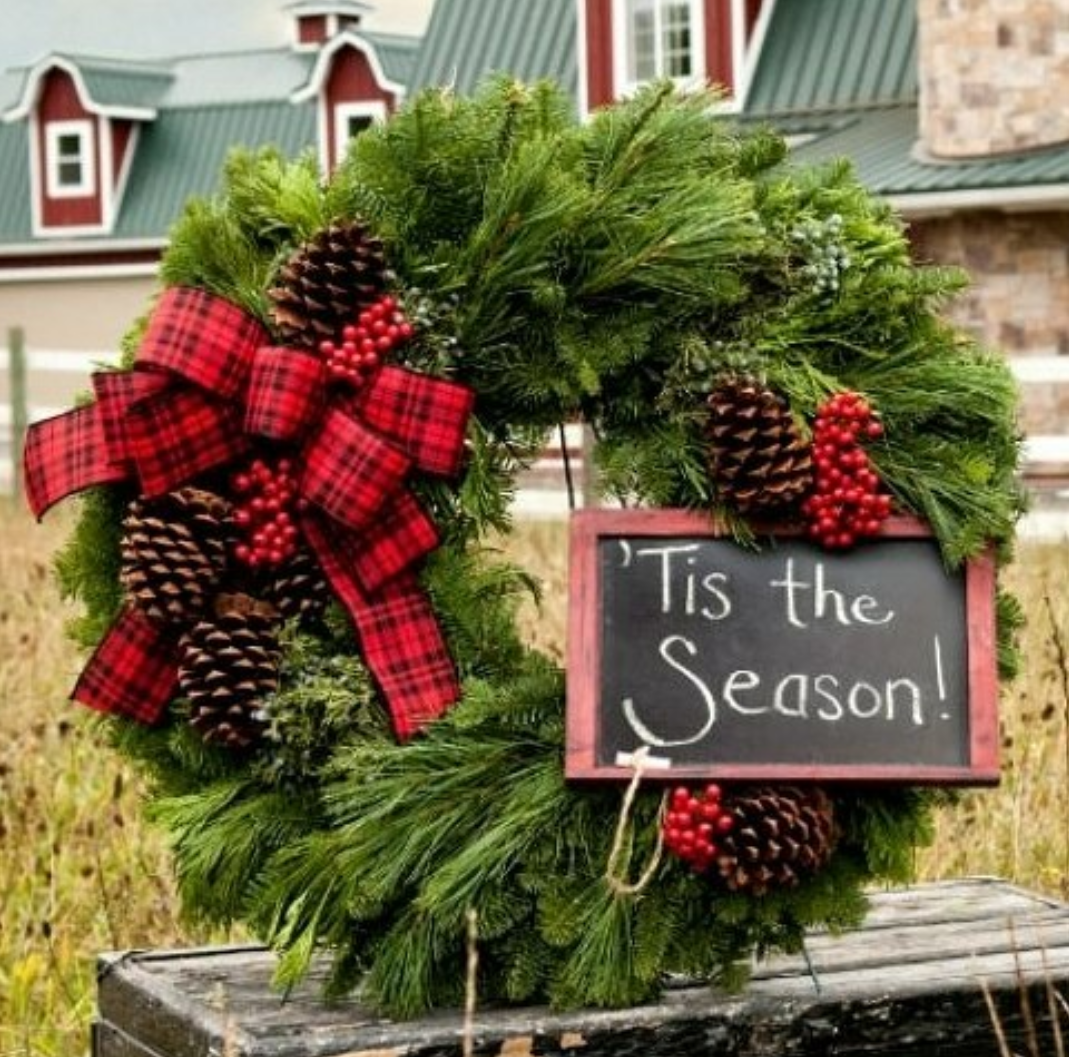 Holiday wreath with a sign that says Tis the season