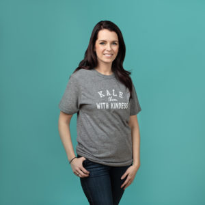 "Grey t-shirt with white text ""KALE them with kindness"""