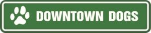 """Logo: Horizontal green rectangle with a white paw print and White text """"Downtown Dogs"""""""